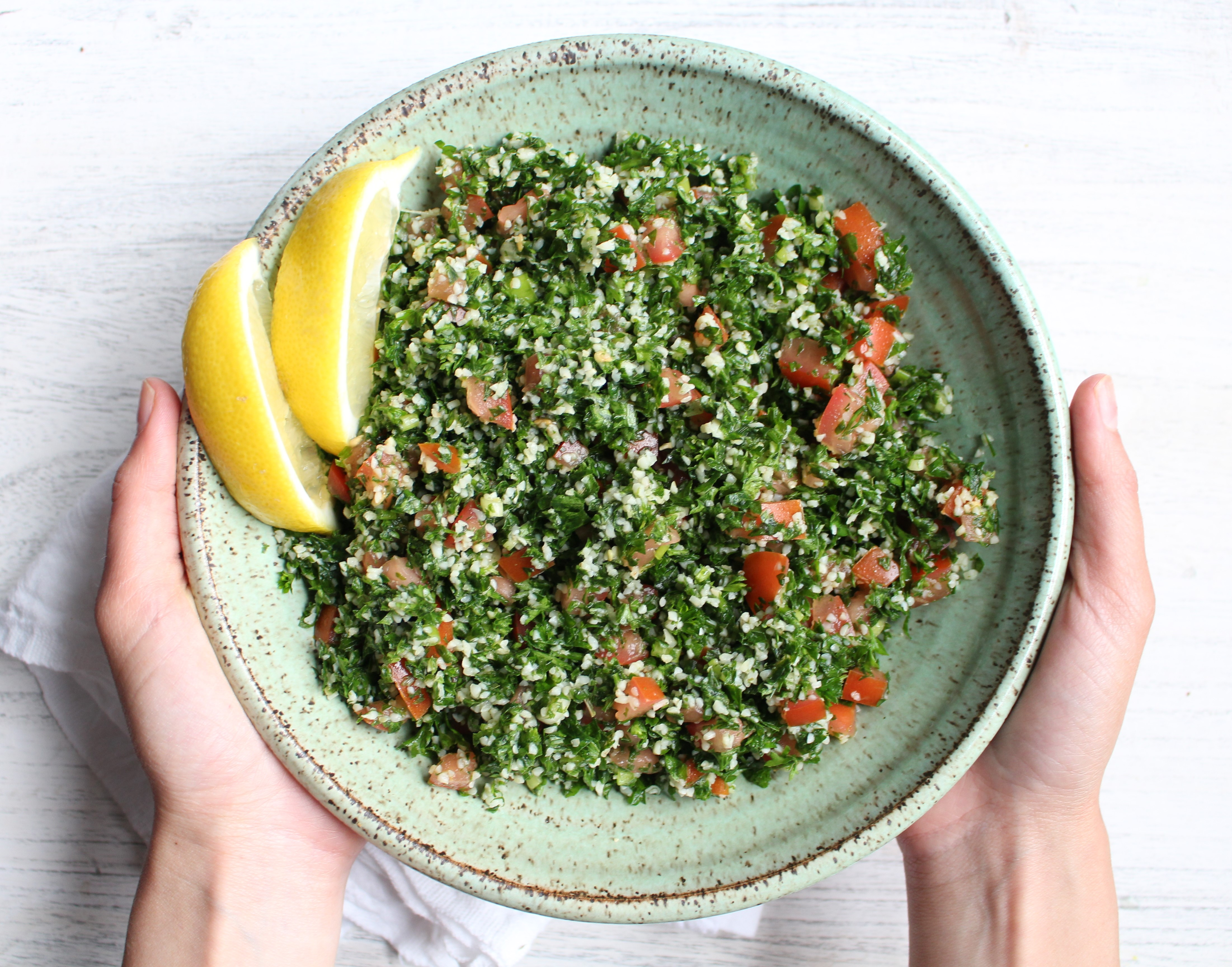 Tabbouleh - a refreshing and healthy Middle Eastern salad made with parsley, tomatoes, and bulgur. Dressed with lemon juice, olive oil, and mint, this salad is great by itself, in lettuce cups, or with avocado!
