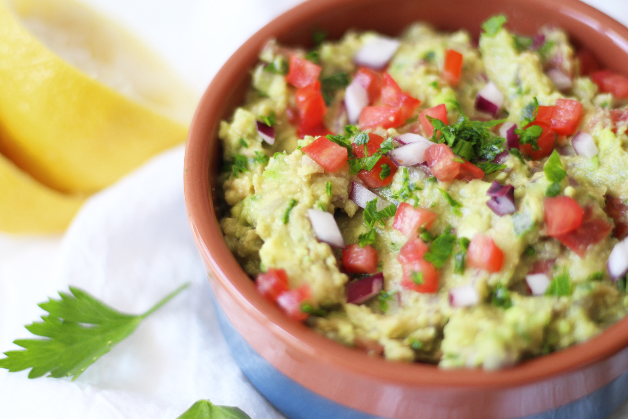Mediterranean Chickpea Guacamole - a fun twist on the classic with the addition of chickpeas! A tasty snack, and not to mention cheaper ingredients!